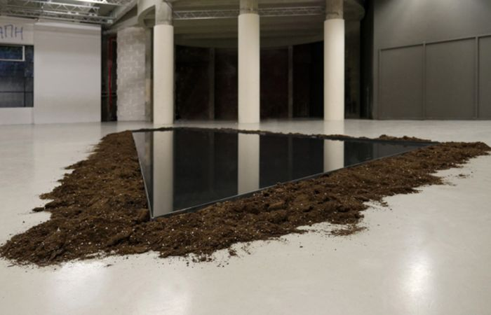 Tomorrow' s Corporate Love (Forgetting from Athens), 2017, Water in Iron Tank,  Soil, Lavender Essential Oil, dimensions variable