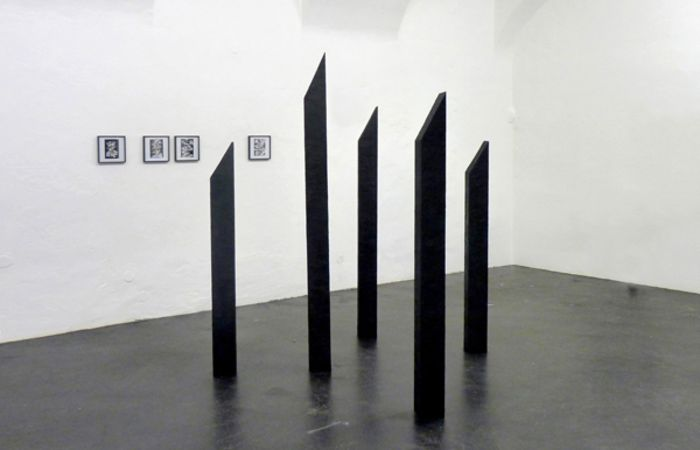 Untitled (5 Oblique Angled Columns Made Out of Tar), 2014, Tar, dimensions variable