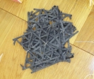 Nikos Alexiou, Untitled, handmade cut out paper, string, dimensions variable